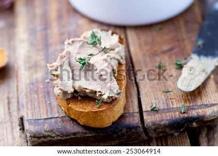 paste from a chicken liver, toasts, a glass with wine on a wooden table. style  rustic. selective focus - stock photo