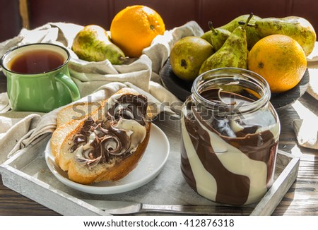 Paste made of white and milk chocolate on bread for Breakfast - stock photo