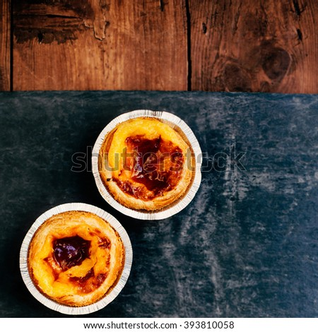Pasteis de nata - typical Portuguese egg tart pastries / egg tart / sweet and delicious dessert - stock photo