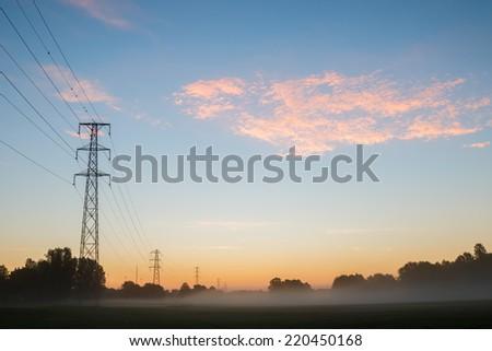 Pastel, autumn sunrise in urban environment - stock photo
