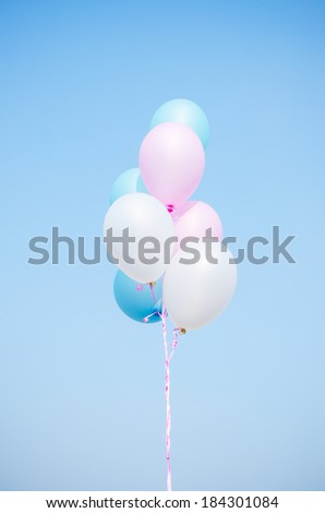 Pastel balloons , Blue, pink and white balloons ,white balloons  , Blue balloons ,  pink balloons  , hold balloons - stock photo