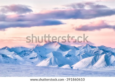 Pastel clouds over the high peaks of the Brooks Range in the Alaskan Arctic