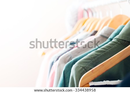 Pastel Color Clothes. Female Clothes on Open Clothes Rail - stock photo