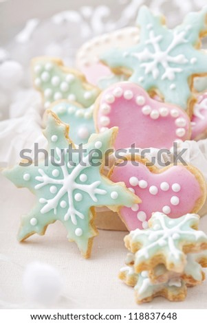 Pastel colored cookies on white background