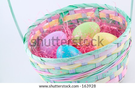 pastel colored easter basket with plastic speckled eggs.