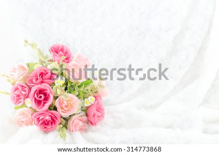 Pastel Coloured Artificial Pink Rose Wedding Bridal Bouquet on white fur background with soft vintage tone - stock photo