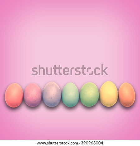 Pastel Easter eggs aligned, pink background - stock photo