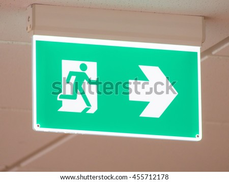 Pastel green emergency exit light sign in the office