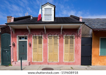Pastel House with Shutters in French Quarter District of New Orleans, Louisiana - stock photo