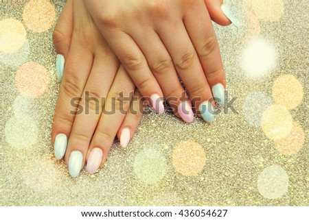 Pastel manicure on female hand