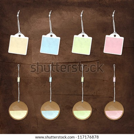 pastel paper tags with string - stock photo