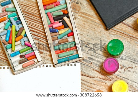Pastel pencils and gouache. Set of the young artist. Development of creative thought. - stock photo