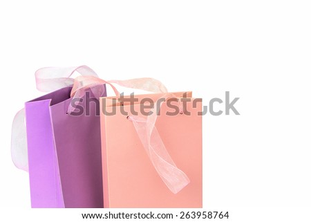 Pastel pink and lilac colorful shopping bags isolated on white - stock photo