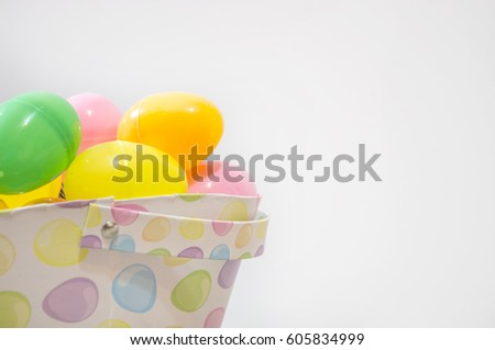 Pastel Plastic Easter Eggs In A Holiday Basket Front Of White Background