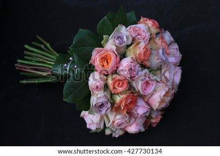 Pastel roses in a bridal bouquet
