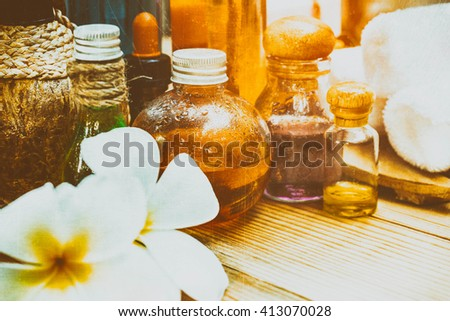 Pastel Spa oils in bottles on wooden table and nature background. Classic style - stock photo