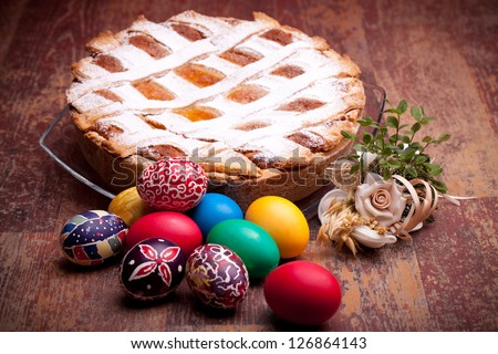 PASTIERA and colorful Easter eggs. Pastiera is a traditional Italian Easter pie made with wheat and ricotta cheese; at Naples is also known as Pizza Gran.
