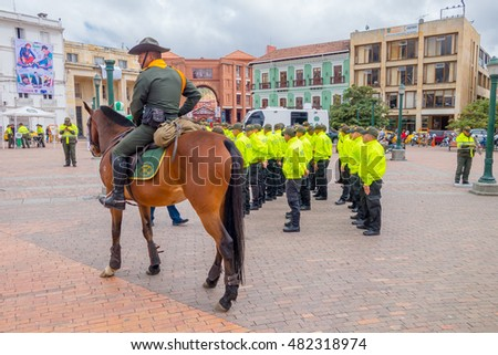 PASTO, COLOMBIA - JULY 3, 2016: unidentified police officer monted on a horse next to some unidentified cops
