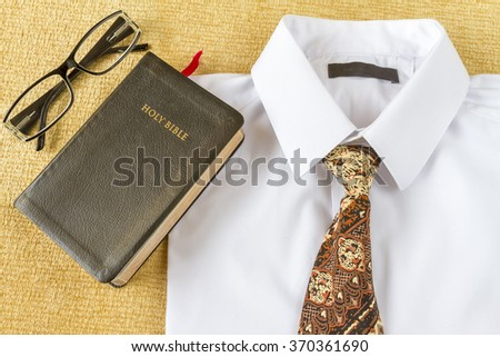 Pastor clothes and Holy Bible with glasses at home. Going to church concept. - stock photo