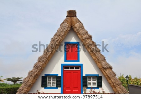 Pastoral landscape. Rural house clear geometric shapes. Madeira, the city of Santana - stock photo