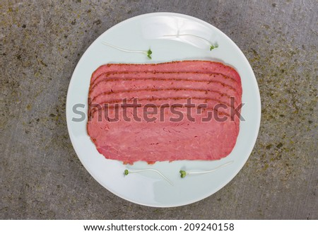 Pastrami and Watercress on a Slate Board - stock photo