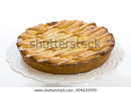 pastry cake with cream and filled with walnuts