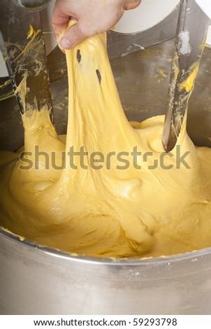 Pastry chef who prepares the cake Panettone - stock photo