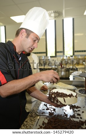 Pastry cook teacher making chocolate cake