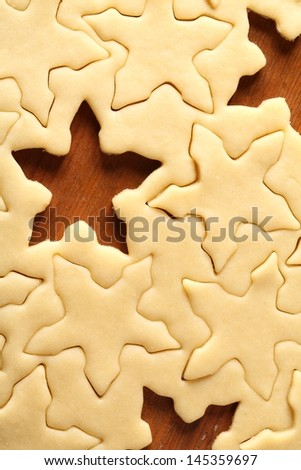 Pastry for Christmas cookies and snowflake shapes.
