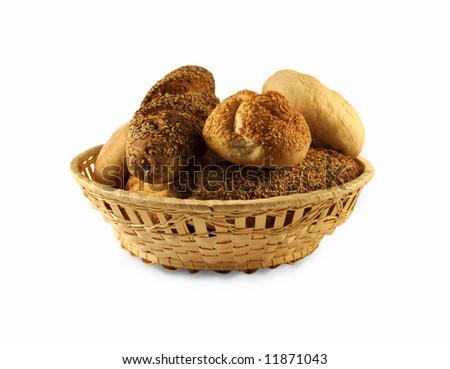 Pastry in bread basket over white - stock photo