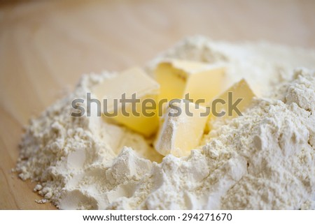 Pastry preparation, butter and flour - stock photo