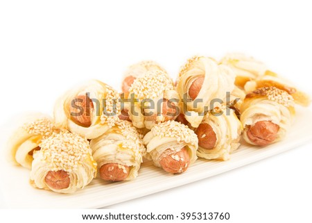 Pastry snack with mini dogs - stock photo