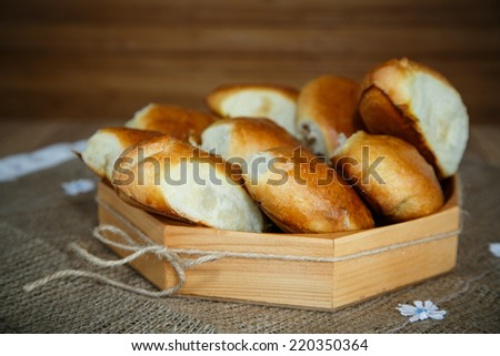 pastry stuffed in a wooden bowl on a table - stock photo