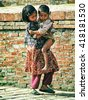 PATAN - DECEMBER 22: Nepalese children at December 22, 1999 in Patan, Nepal. Nepalese children are poor, so they hang around in the city while their parents try to get some work. - stock photo