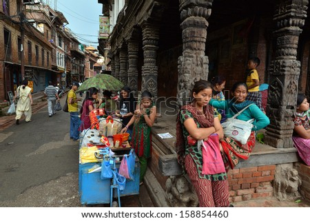 PATAN - SEPT 28 : Nepali people enjoying the first day of  Dashain festival on the streets of the Unesco city of Patan, the old capital of the Kingdom of Nepal. On Sept 28, 2013 in Kathmandu, Nepal