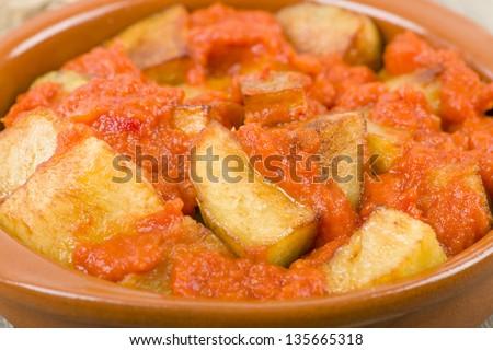 Patatas Bravas - Crispy potato chunks in spicy tomato sauce. Traditional Spanish tapas dish. - stock photo