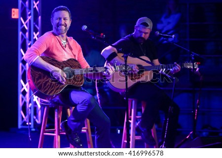 PATCHOGUE, NY-FEB 3: Musician Craig Morgan (L) performs onstage at The Emporium on February 3, 2016 in Patchogue, New York. - stock photo