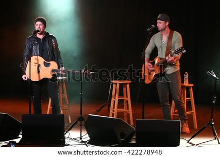 PATCHOGUE, NY-FEB 3: Musicians Stephen Barker Liles (L) and Eric Gunderson of Love and Theft perform onstage at The Emporium on February 3, 2016 in Patchogue, New York. - stock photo