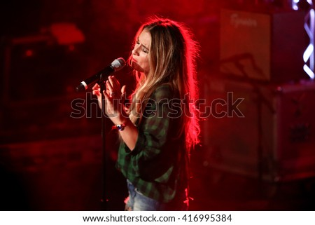PATCHOGUE, NY-MAR 9: Singer Jessie James Decker performs onstage at the Emporium on March 9, 2016 in Patchogue, New York. - stock photo