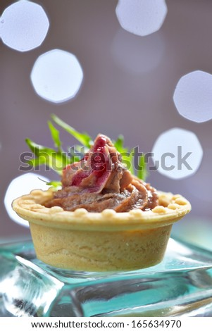 Pate tartlets with cranberry sauce - stock photo