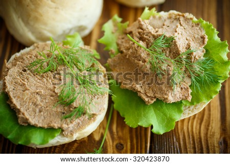 pate with bread on a wooden table - stock photo