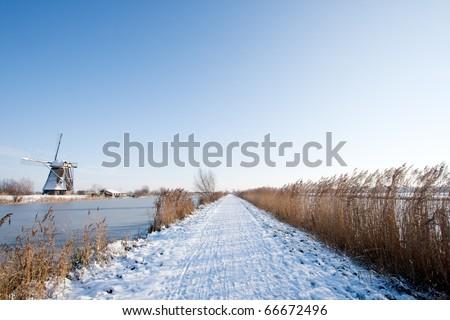 Path along the windmills in Kinderdijk. Holland - stock photo