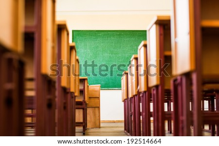 Path between desks in a classroom - stock photo