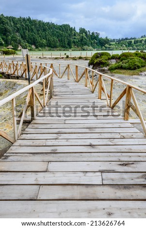 Path between hot springs and fumaroles at the edge of Furnas lake, Azores, Portugal, Europe - stock photo