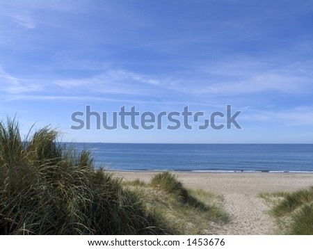 Path crossing sand dune, western Jutland, Denmark. view to the North sea. - stock photo