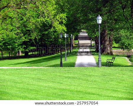 Path in a green park - stock photo