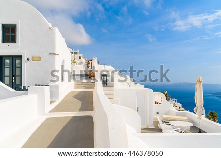 Path in beautiful Firostefani village with typical white architecture, Santorini island, Greece