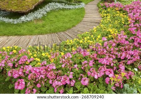 Path in Ornate Flower Garden - stock photo