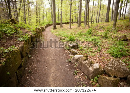 Path near an ancient fortress wall - stock photo