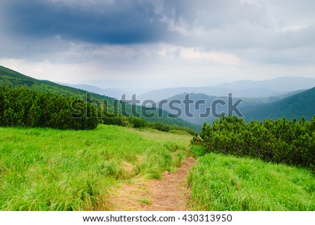 Path on the mountains in nasty day - stock photo